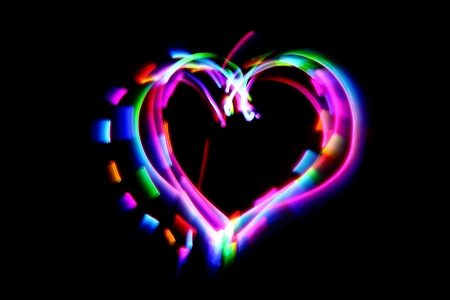 love explode: heart from the color lights in the dark night Stock Photo