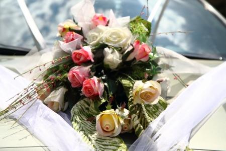 wedding flower background on the white car photo