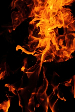 nice fire in the night as danger background Stock Photo