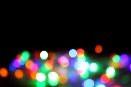 Christmas Lights In The Dark Night As Nice Xmas Background Stock ...