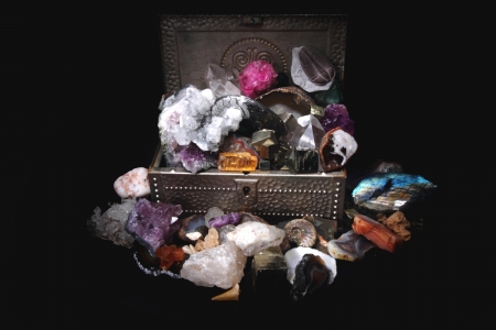 amazonite: minerals and gems in the steel box in the dark
