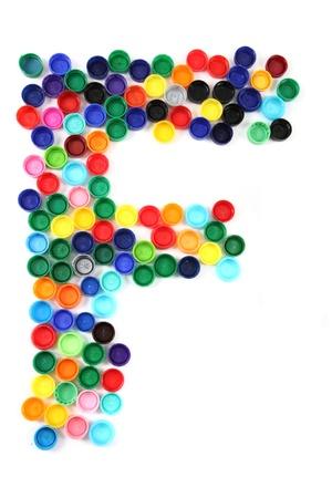 plastico pet: F carta del alfabeto plástico aislado en el fondo blanco Foto de archivo