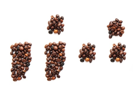 coma: coma and other signs  from coffee beans isolated on the white background
