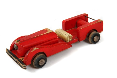 old red car toy isolated on the white background photo