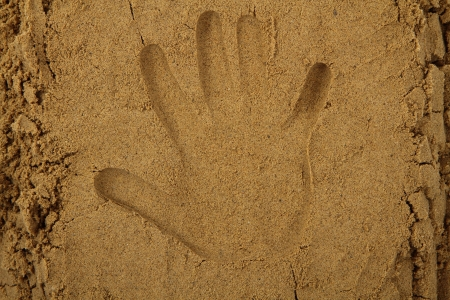 hand print as nice summer sand background photo