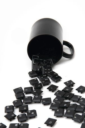 chaos black keyboard keys in the pot isolated on the white background photo