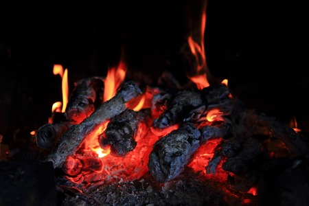 fireplace background  fire texture  in the dark photo