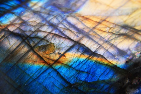 Labradorite mineral background  blue and yellow typical texture  Stock Photo