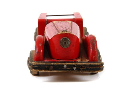 old red wooden car toy isolated on the white background photo