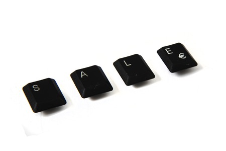 sale from the keyboard keys isolated on the white background photo