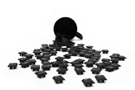 keyboard keys in the black pot isolated on the white background photo