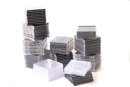 recordable media: plastic empty CD and DVD boxes isolated on the white background