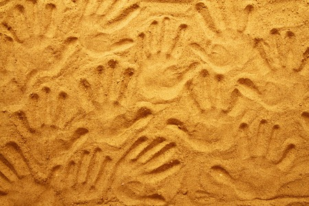 hand prints in the sand as nice summer background photo