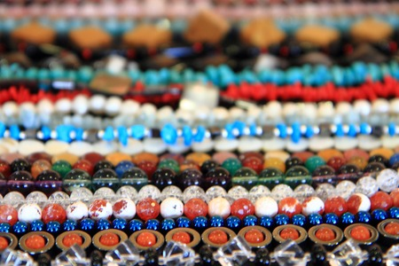 bracelets with natural and synthetic beads as nice color background photo