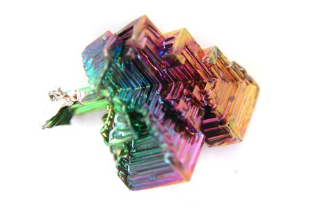 bismuth: bismuth  Bismuthum - Bi  color metal crystal isolated on the white background
