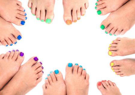 color womens legs and nails isolated on the white background