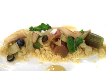 rhubarb dessert with blueberries, almonds, sweet mint as nice food background photo