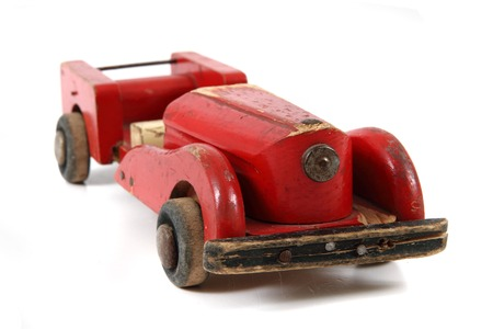wolverine: old red wooden car toy isolated on the white background