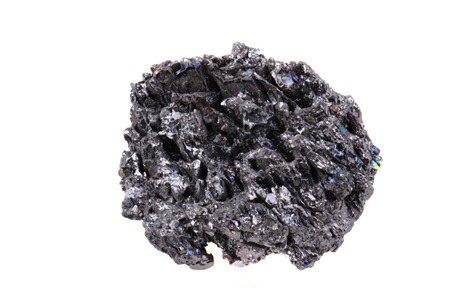 synthetic corundum mineral (look like meteor) isolated on the white background photo