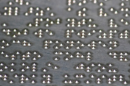 braille alphabet in the stell as nice background photo
