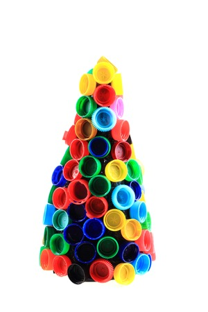 chriostmas tree from color plastic caps isolated on the white background photo