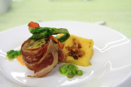 bacon roll with spring vegetable as groumet food photo