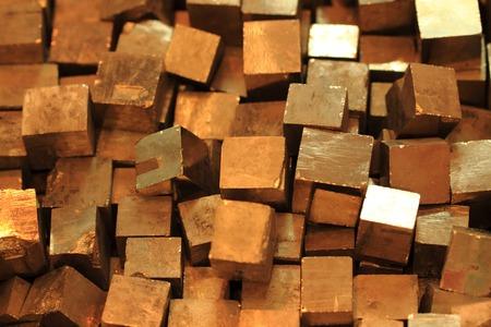 pyrite: golden cubes background (natural pyrite mineral texture)