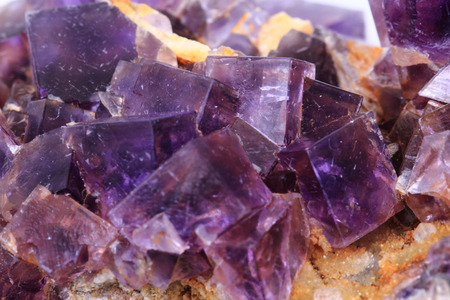 fluorite: violet fluorite cubes as natural mineral background
