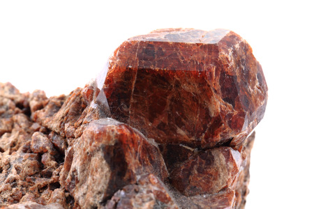 hydrothermal: brown garnet mineral isolated on the white background