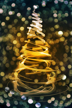 xmas background: christmas tree form the color xmas lights as holiday background Stock Photo
