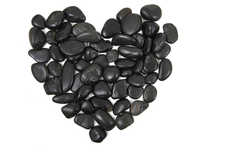 beauty spa: black stones heart isolated on the white background