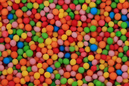 many coloured: color sweet spheres as nice food background Stock Photo