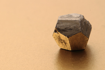 pyrite: pyrite cubes isolated on the golden background