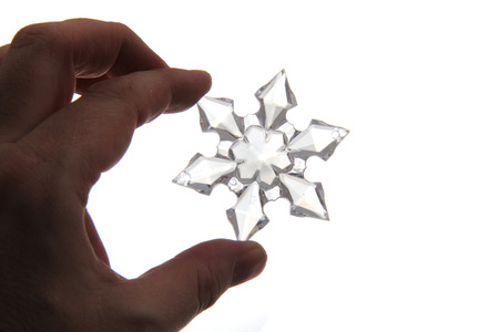snoflake: snoflake in the human hand isolated on the white background Stock Photo