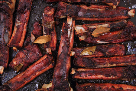 nice food: smoked pig ribs as very nice food background Фото со стока