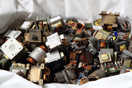 scrapheap: old transformer garbage from electronic recycle industry Stock Photo