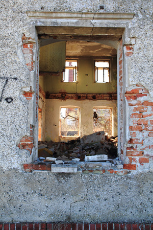 damaged house: old window from damaged house as background