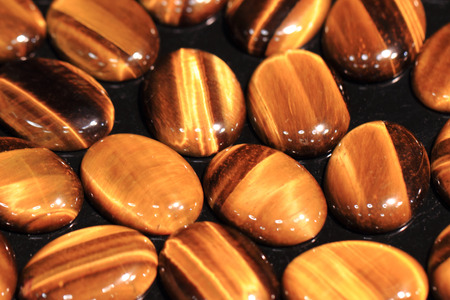chatoyant: tiger eye minerals as very nice background Stock Photo