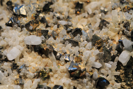 oscillations: crystals in the lead as natural mineral background