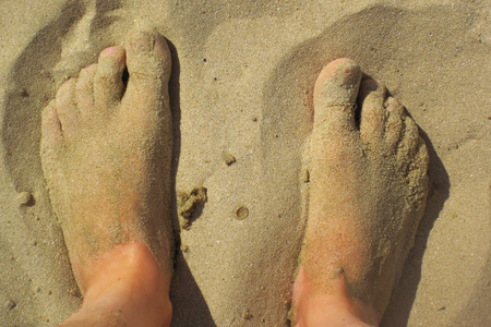 fine legs: man legs in the sand as relax background Stock Photo