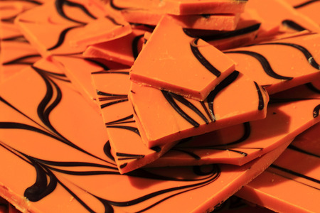 molted: orange chocolate as nice sweet food background Stock Photo
