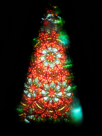 color kaleidoscope as christmas tree isolated on the black background