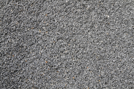 macadam: gray broken stone background (road metal) as easy texture