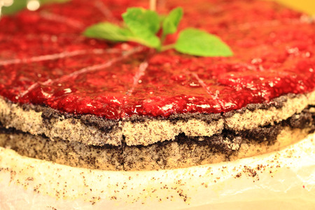 nice food: raspberries cake with mint as nice food background Фото со стока