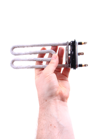 calcification: damaged wash machine heater isolated on the white background