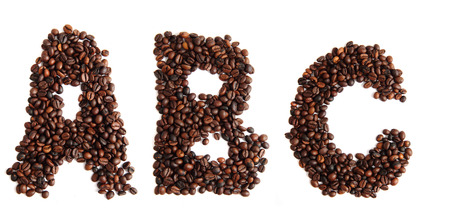 alphabet from coffee beans isolated on the white background Stock Photo