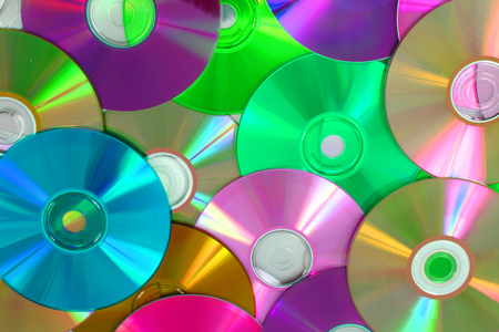 CD and DVD as color technology background Stock Photo