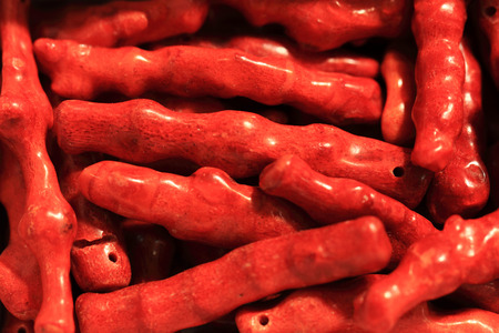 beautiful red coral material for necklaces as background