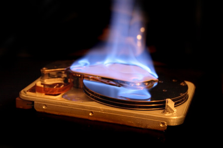 harddisc: disc in the fire on the black background