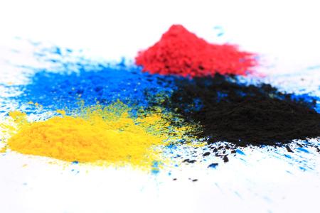 cmyk toner powder (cyan, magenta, yellow, black) isolated on white background